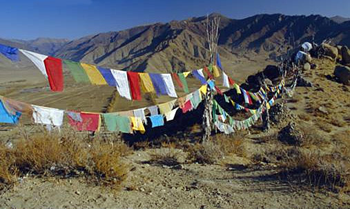 an image of Tibetan prayer flags in the mountains of the Himalayas